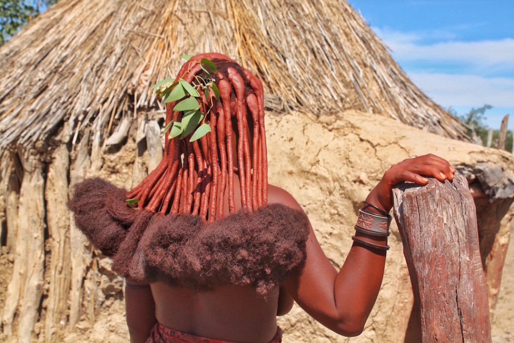 Local woman with traditional hair in Himba Tribe, Opuwo, Namibia