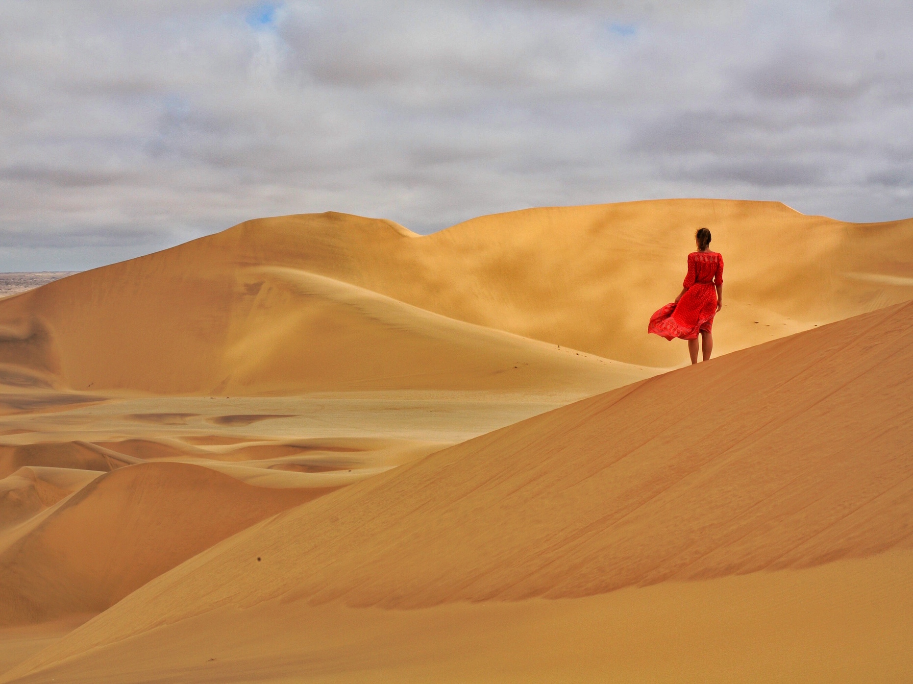 Girl in red at Sand Dunes in Dorob National Park, Namibia