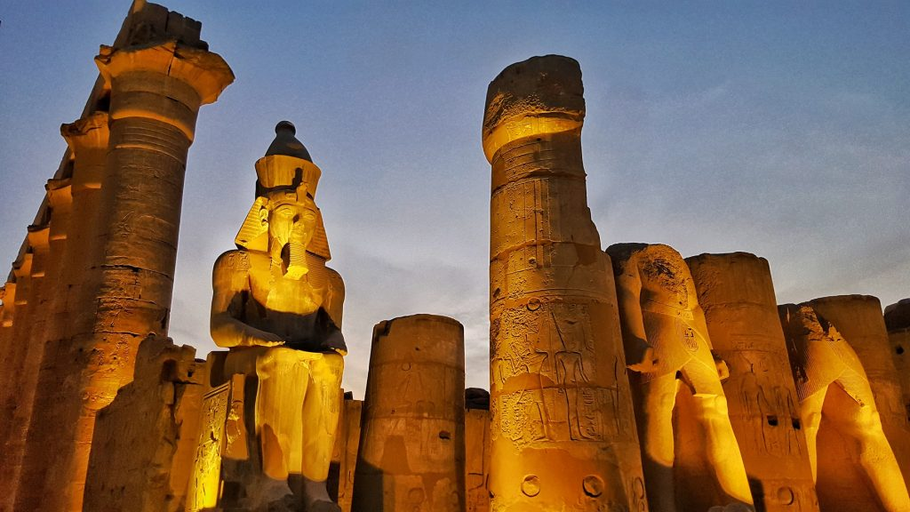 ancient Egyptian structure lit by lights