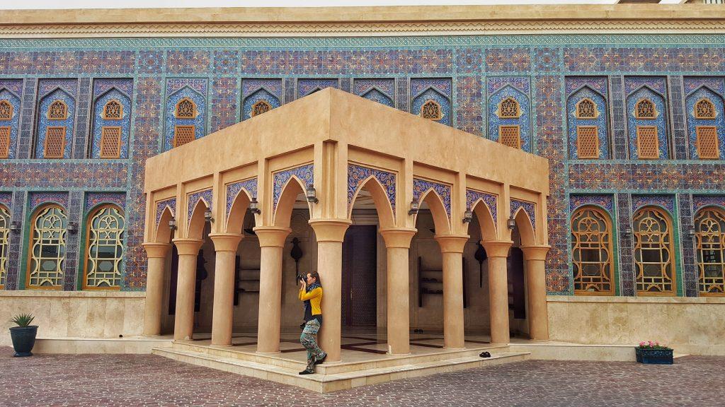 beautiful islamic building with woman taking photos at Katara