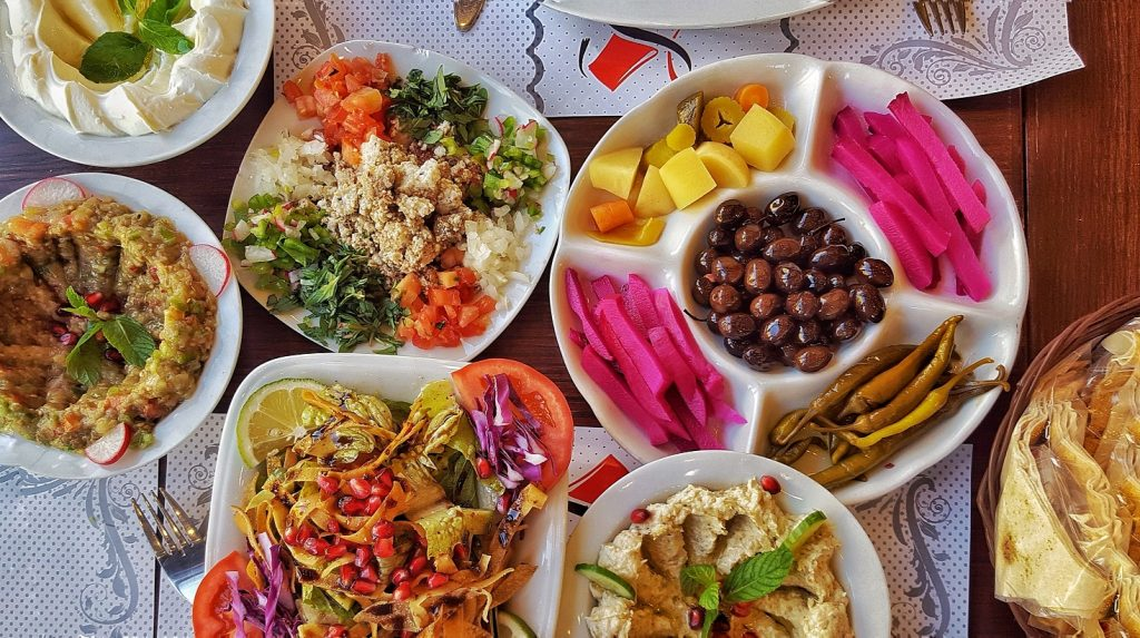 Traditional Lebanese Food with pink yellow and red colors