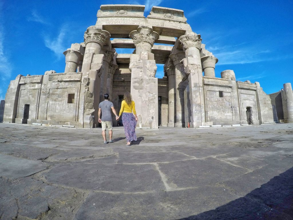 couple holding hand over looking Kom Ombo Temple