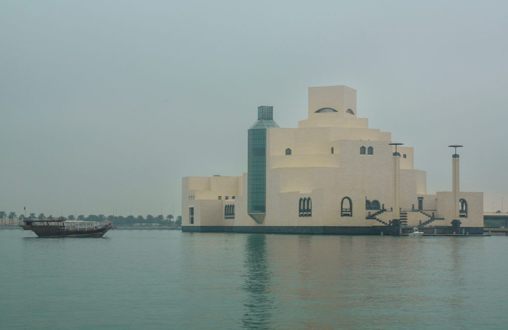 white structure with reflection in the water of Museum of Islāmic Art