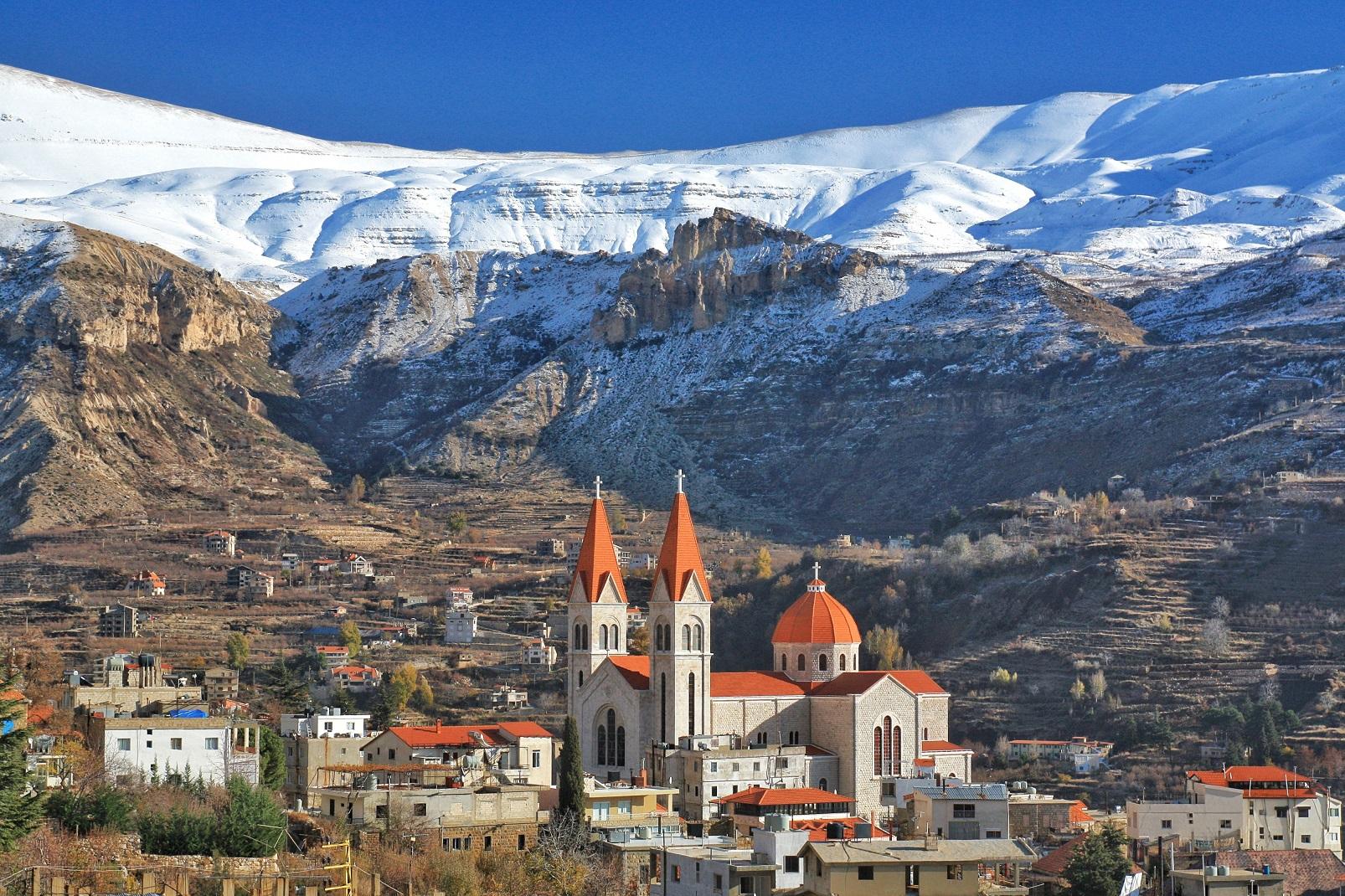 Snow covered mountains and Saint Saba Church in Bsharre, Lebanon