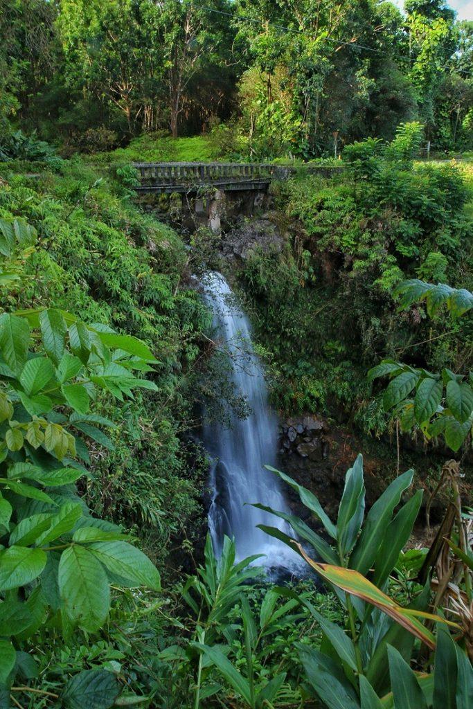 Green West Wailua Iki Waterfalls underneath bridge