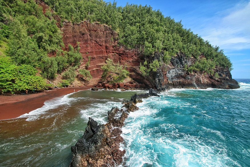 Incredible view of red beach and red rocks at Kaihalulu Beach