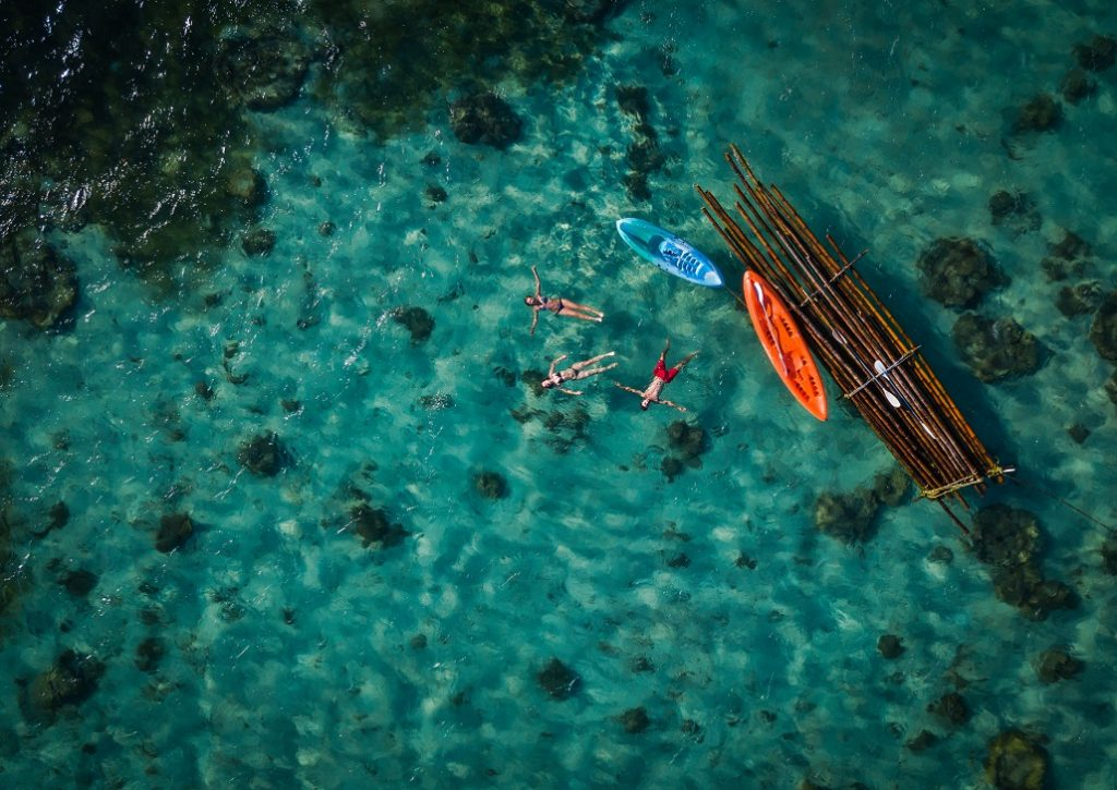 top down view of people in kayak and raft at Viti Levu in Fiji