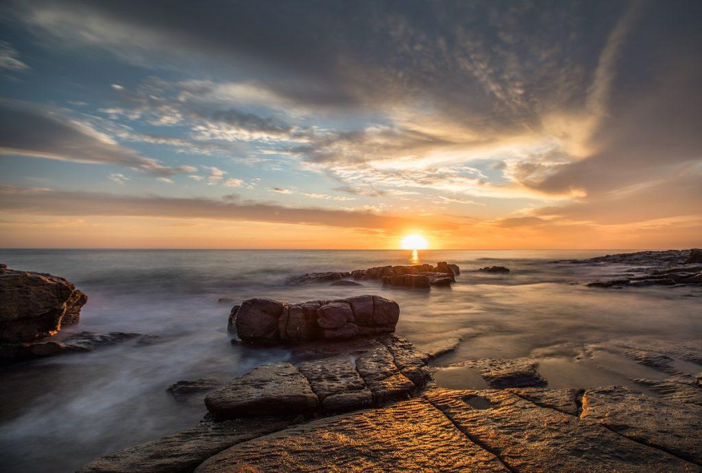 Sunrise in Australia with long exposure ocean tide