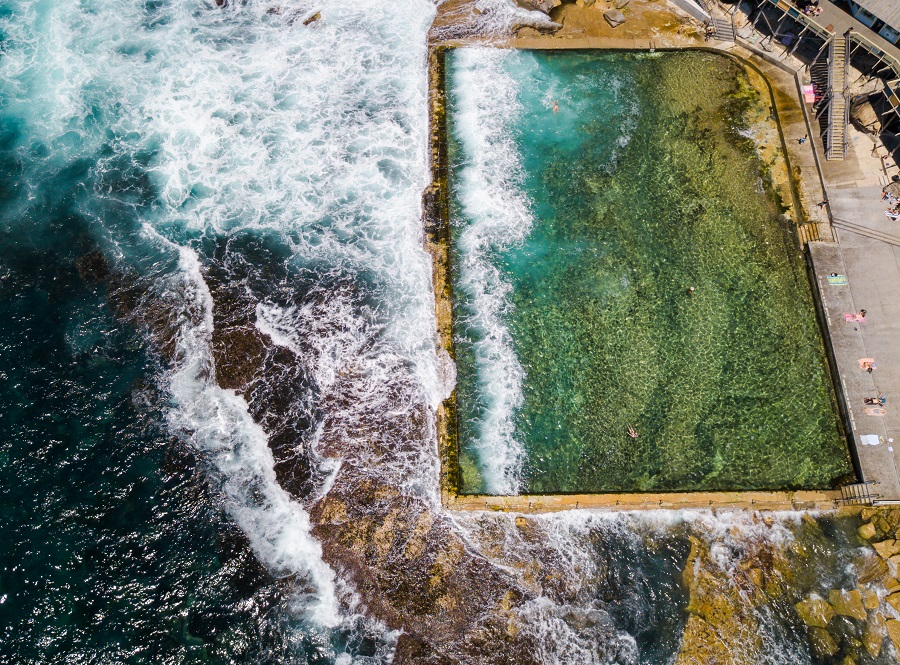 Aerial view of humans swimming Wylie's Baths, Coogee