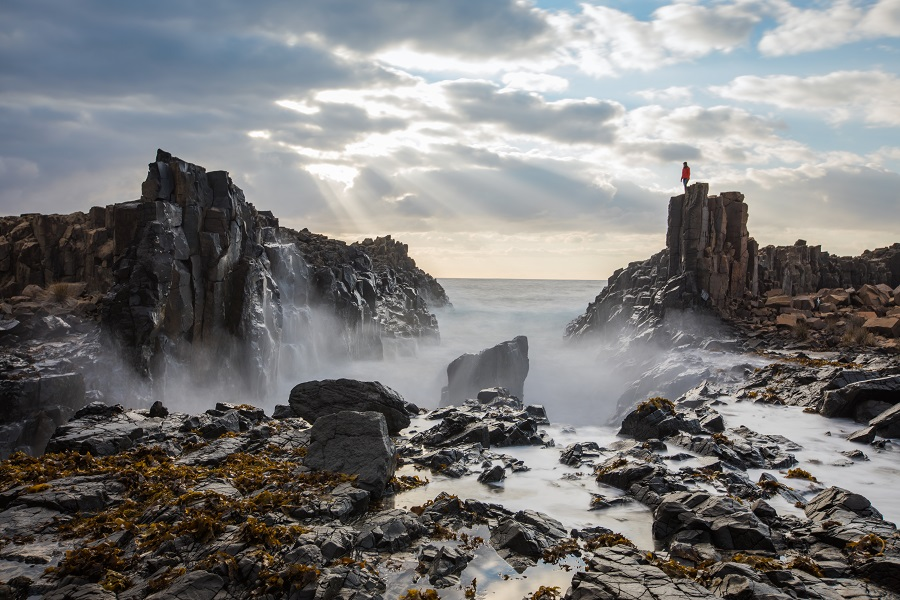 Person on top of Bombo Quarry panoramic