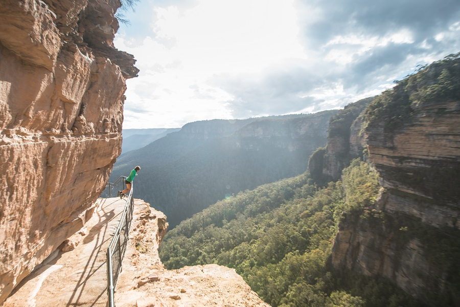 Girl in green on ledge at National Pass walk