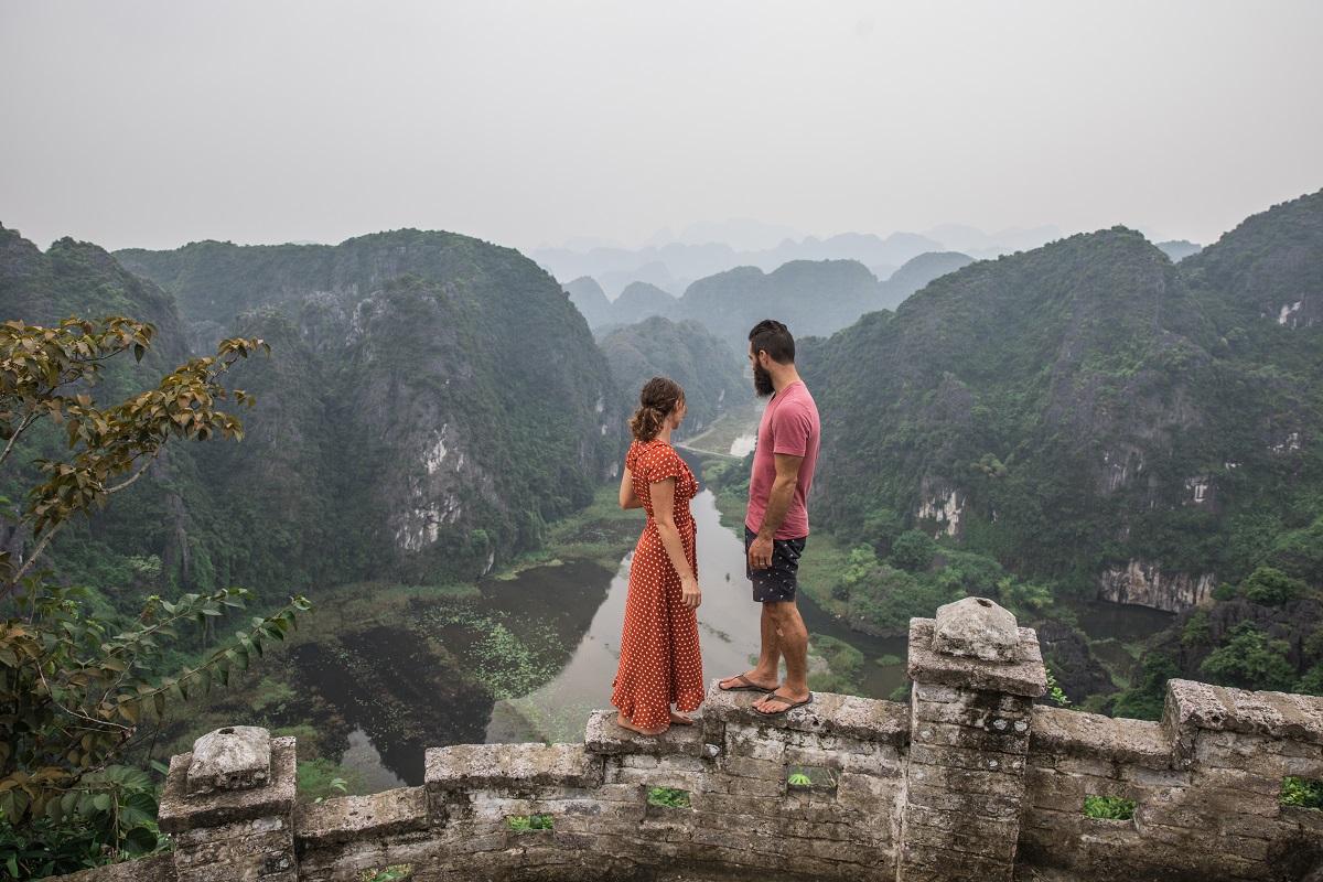 Couple looking back at Ninh Binh at Moa Caves